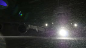 Airliner turns on the runway. At night, in the winter. Airliner turns on the runway. At night, in the winter in a snow storm stock video footage