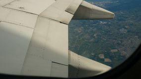 Airliner wing raises flaps to prepare for landing. Transport stock video footage