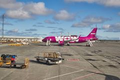 Airliner of WOW Air. KEFLAVIK ICELAND - APRIL 28, 2018: Wow Air Airbus A320 at Iceland`s international airport. WOW Air started to offer connecting flight stock photography