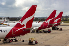 Airliners Taking Passengers. MELBOURNE/AUSTRALIA - SEPTEMBER 22, 2015: Heavy Jetliners parked at passenger terminal taking on passengers Stock Images