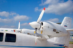 Airlines. Side engines of a small white plane Royalty Free Stock Photo