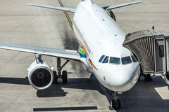 Airlines plane prepares for passengers to board Royalty Free Stock Photo