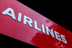 Airlines Sign. Airlines text written with white on red background Royalty Free Stock Images