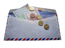 Airmail envelope. An airmail envelope and Euro coins Stock Photography