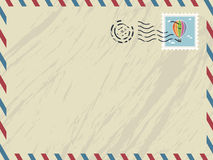 Airmail envelope. Envelope with airmail stripes, post mark and stamp Royalty Free Stock Images