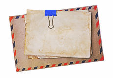 Airmail envelope and blank paper sheet. Isolated on white background Stock Images