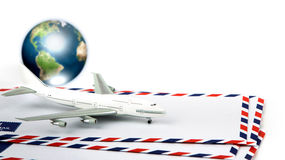 Airmail envelope with model airplane and earth Royalty Free Stock Photos