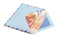 Airmail envelope with a money. Over white background Royalty Free Stock Images