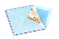 Airmail envelope with a money. Over white background Stock Image