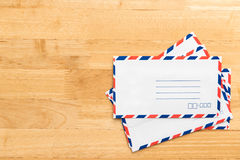 Airmail envelope on table. Airmail envelope on wood table Stock Photography