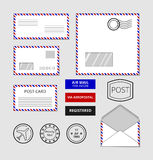 Airmail envelopes, postcard and badges vector set Royalty Free Stock Photography