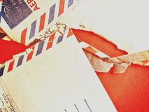 Airmail envelopes on red Royalty Free Stock Image