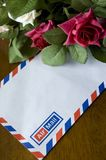 Airmail and roses Royalty Free Stock Photos