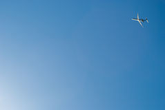 Airoplane take off on dramatic blue sky. Airplane after take off flying through a rich blue sky Stock Image