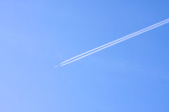 Airplain with  contrai. Airplain with contrail in summer sky Royalty Free Stock Images