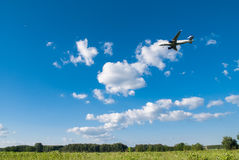 Airplain flying. Airplain on the blue sky Stock Image