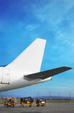 Airplain tale and luggage cart Stock Image