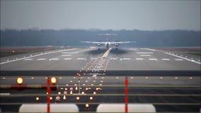 Airplane is landing on runway. Airplan is landing, view from backside stock video