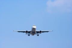Airplan nel cielo Immagini Stock
