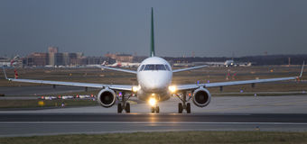 A airplan on the runway in the evening Stock Images