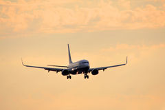 Airplan at sunset. Airplan flying on the sky at sunset Stock Image