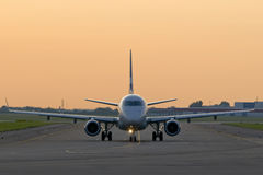 Airplane. On the ground ready to take-off in the evening light stock photo