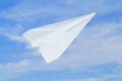 Airplane. A paper airplane in front of blue sky Stock Photo