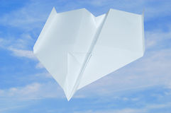 Airplane. Paper airplane in fligt with blue sky Stock Photography
