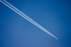 Airplane. An airplane streaking across the sky royalty free stock photo