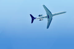 Airplane. An airplane. view from below. blue sky Royalty Free Stock Photography