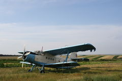 Airplane. Small airplane on grass field Royalty Free Stock Photography