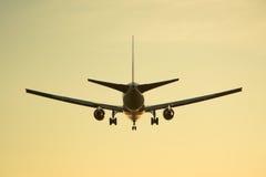 Airplane. Plane landing or flying away during sunset or sunrise Royalty Free Stock Photos