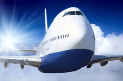 Airplane. At fly on the sky with clouds Royalty Free Stock Photo