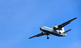 Airplane. Air Travel: An airplane against a Vivid Blue Sky with Plenty of Copy Space Stock Image