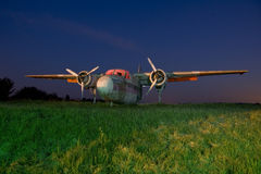 Airplane. Old abandoned airplane disued in an old airfield at night with star trails Stock Photos