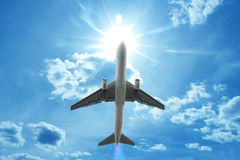 Airplane. Flying in the blue sky Stock Photo