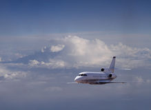 Airplane. Passenger airplane flying over clouds in sky Royalty Free Stock Image