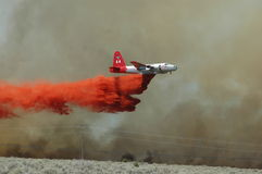 Airplane. Firestorm on BLM and wildfire came out nowhere near home area Royalty Free Stock Images
