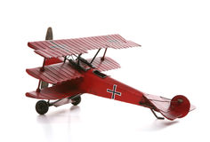 Airplane. An old antique model airplane over a white background Stock Image