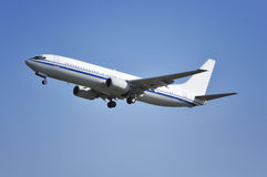 Airplane. Boeing airplane flying in blue sky Royalty Free Stock Images