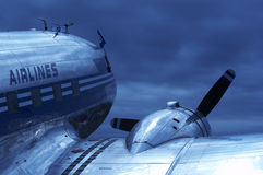Airplane. Old airplane (dc-3) with blue toning against the sky Royalty Free Stock Image
