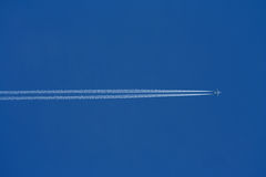 Airplane. In the wide blue sky. holiday stock photo