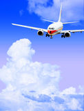 Airplane. Isolated over sky background Stock Photos