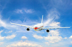 Airplane. Isolated over sky background Stock Photo