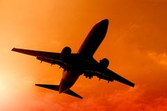 Airplane. Flying in the sunset Stock Photography