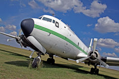 Airplane. Old passenger airplane parked on the grass Royalty Free Stock Photos