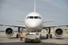Airplane. Passenger aircraft parked at the airport Stock Photos