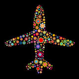 Airplane. Vector illustration of airplane shape made up a lot of multicolored small flowers on the black background stock illustration