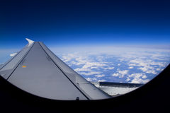 Airplane. View from the window of an airplane. Soft clouds and the wing Royalty Free Stock Images