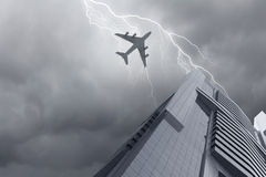 Airplane above city Stock Image